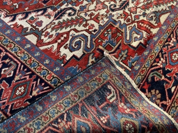 Classic Heriz Karaja carpet hand-knotted.  Provenience: Heriz Karaja  Design: Heriz traditional Collection: vintage and antique  Colors: rust red, blue indigo, beige, green  Pile hand-knotted fine virgin sheep's wool  Size: oversize carpet  Age: Approx. 1